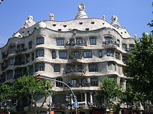 """One of Gaudi's most well known projects is the """"Casa Mila"""". The house is created of stone and has curved lines in all aspects of it."""