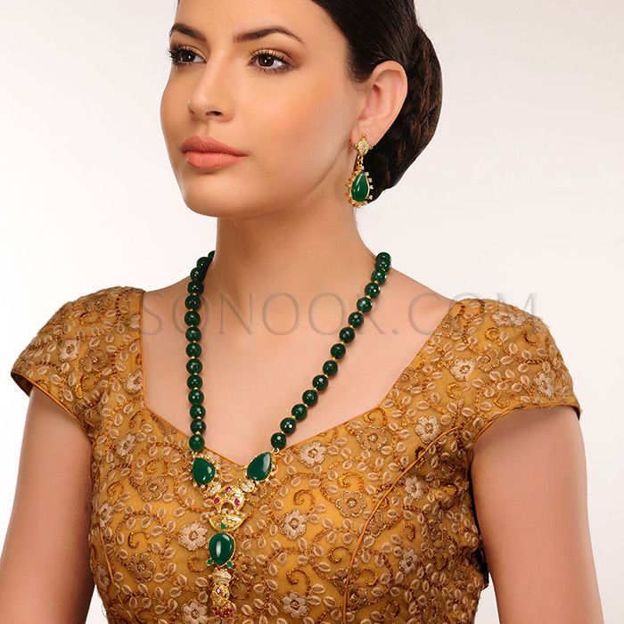 PEN/1/3423 Inika Pendant Set with Earrings in gold finish studded with jade and cubic zircons 	 $188	 £111