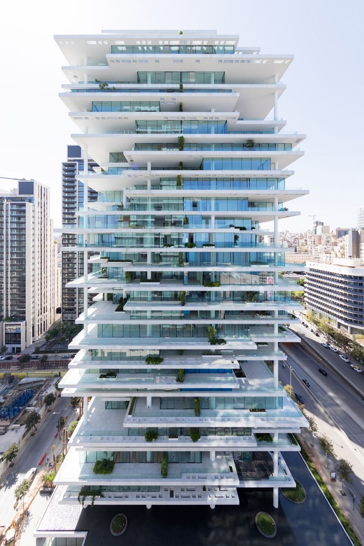 Staggered floor plates and set-back glazing create large planted terraces around this 119-metre tower by Swiss architects Herzog & de Meuron, which overlooks Beirut's marina.