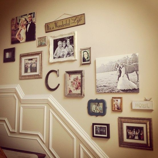 Pictures on the stairs. Love the different shapes and signs.