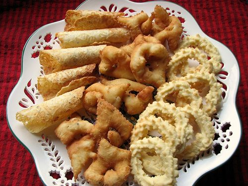 """Traditional Norwegian cookies. L to R.   Krumkake, Fattigman, """"S'er"""", or 'Spritz'  Often S'er gets made like a wreath w/simple tiny red piece of cherry w/green leaf on each side.(made of colored fruit)"""