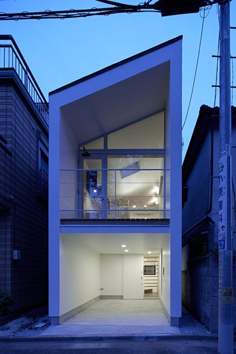 The Japanese architecture firm, Another Apartment, designed this small house on a narrow lot in suburban Tokyo. The house features a glazed façade that pro
