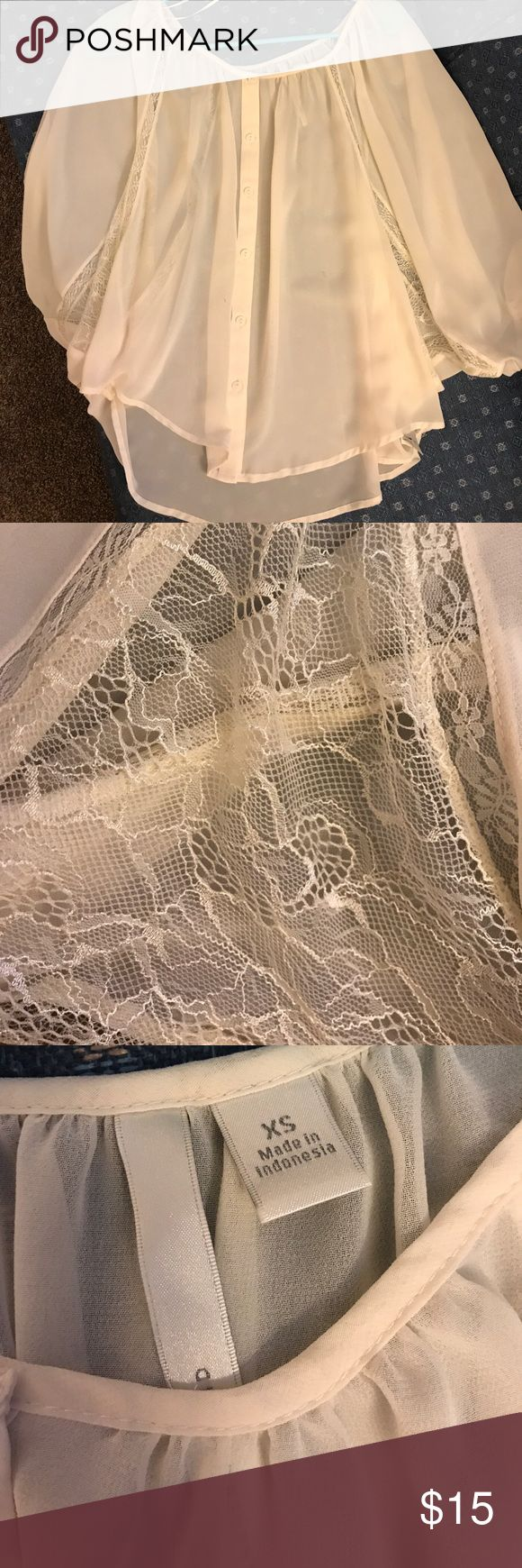 Lauren Conrad Cream Flowy Top This is a Top that will be stylish for ages. It has gorgeous Lace detail and it's about 3/4 sleeves. It's very nice and flowy and beautiful. There are a few black marks on it but they can probably be washed out, otherwise it's in great condition! Comes from a smoke free home! LC Lauren Conrad Tops Blouses