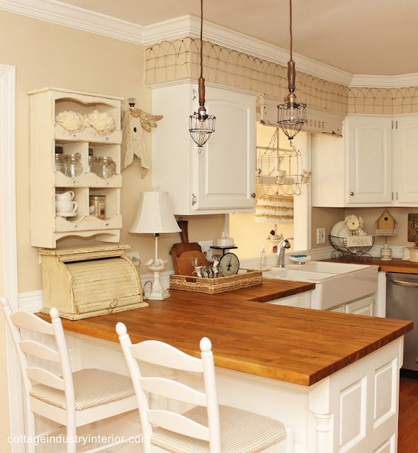 A Sort Of Fairytale Cottage Eye Candy Note Short Fencing Along Cabinets Tops