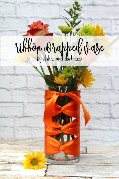 ribbon wrapped vase for a bouquet of flowers