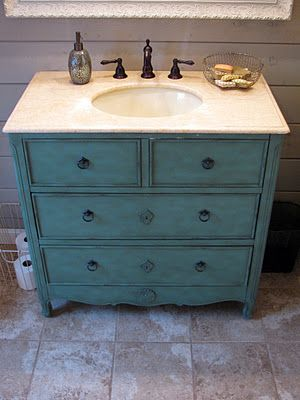 bathroom makeover, great use of an old flea market dresser.