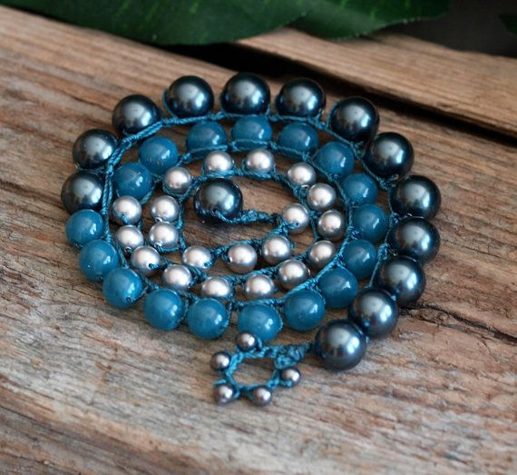 Big and bold, yet super comfortable to wear, this triple wrap bracelet features a row of 10mm Tahitian Swarovski Pearls and a row of 6mm Grey