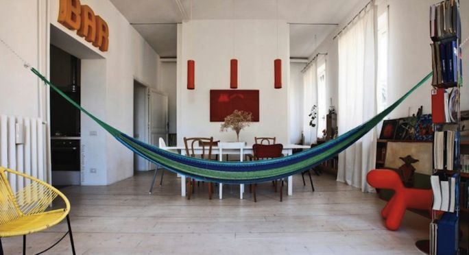 The blue hammock in the living space, loft in Rome, Italy.