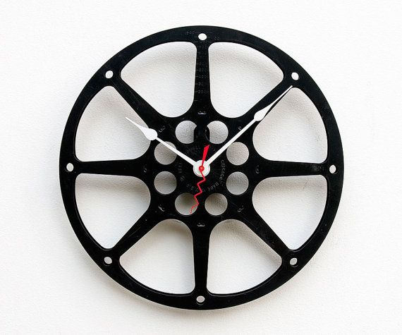 Clock made from a recycled film reel.