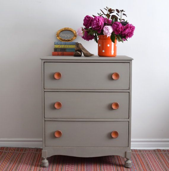 Neutral Dresser with Orange Pulls  Painted with by Poppyseedliving
