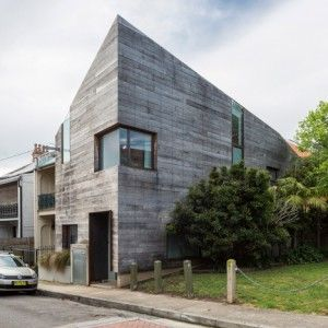 Stirling House is a Sydney home  clad with rough timber boards