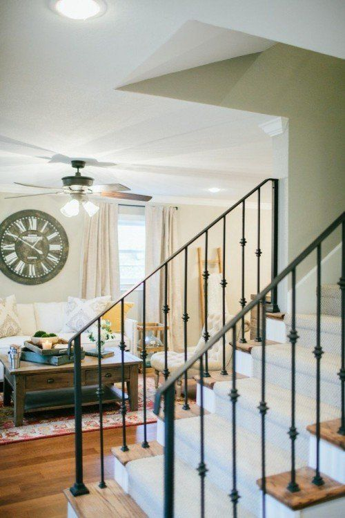 """Haire32  She also selected a carpet runner for the stairs and a light color, """"Amazing Gray"""", for the walls. The new front door also added a significant amount of natural light to brighten the space as well. Joanna designed sliding barn doors in the foyer leading into the client's office"""