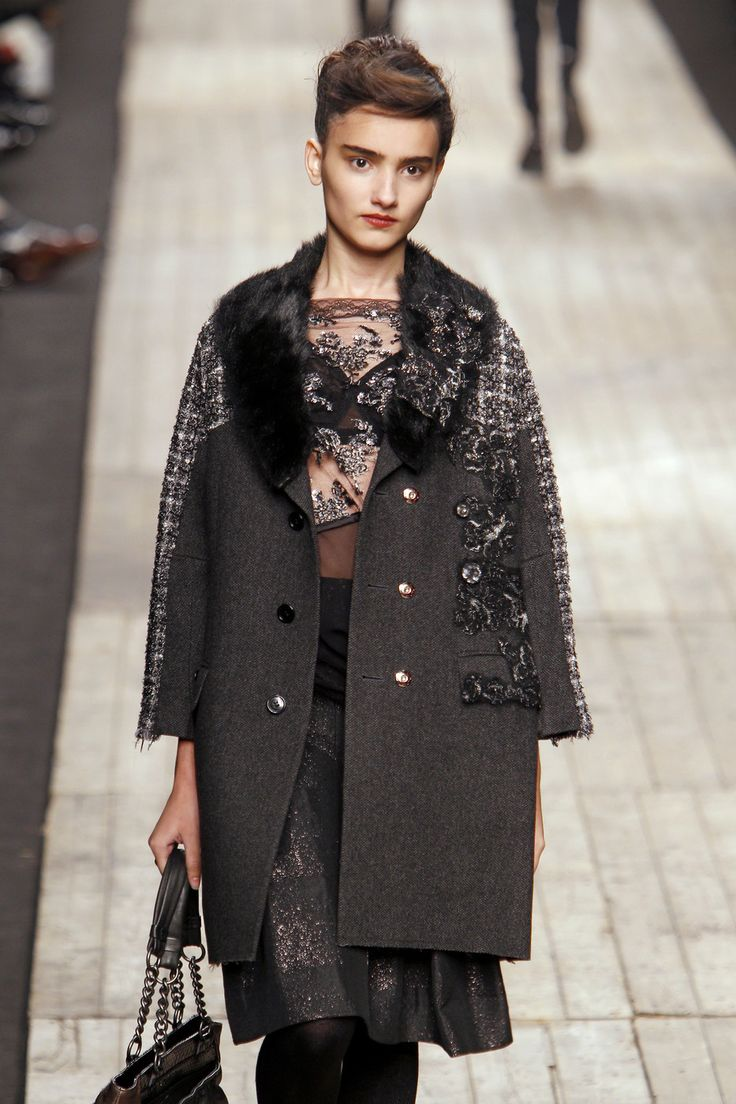 combining varied fabrics in knee-length coat by Antonio Marras at Milan Fall 2010