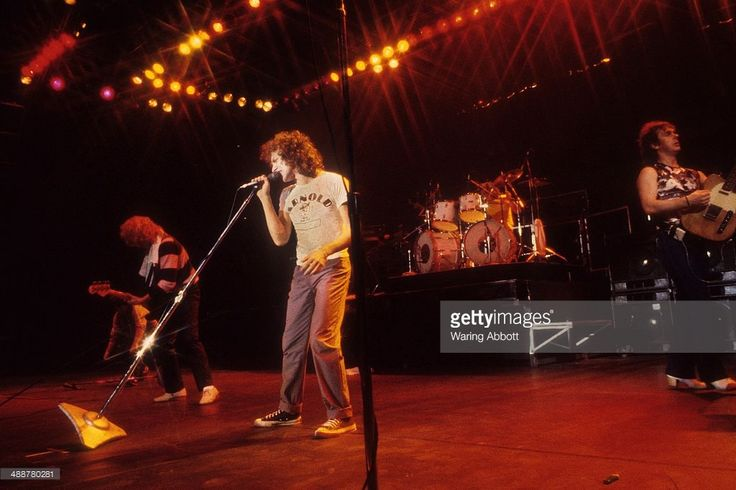 British bassist Rick Wells, American vocalist Lou Gramm and British rhythm guitarist and multi-instrumentalist Ian McDonald of the British-American rock group Foreigner performing live at New Haven Veteran's Coliseum on January 1, 1979 in New Haven, Connecticut.