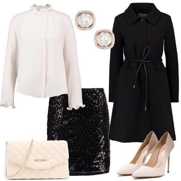 Camicia in seta bianca con colletto alla coreana, minigonna nera con pallettes e cappotto classico nero. Décolleté bianca e taupe, borsa a tracolla avorio e orecchini a bottone.