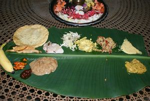 Kerala Onam Pictures: Onasadya is the grand feast that's served during Onam celebrations in Kerala. It's prepared on the main day of Onam, and dished up on a Banana leaf.
