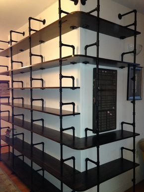 Pipe shelves with built in book ends                                                                                                                                                      More