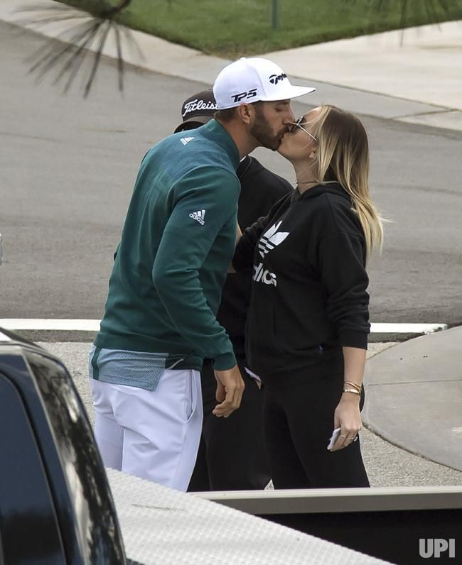 Dustin Johnson kisses Paulina Gretzky prior to his first round at the 2017 Masters Tournament at Augusta National Golf Club in Augusta,…