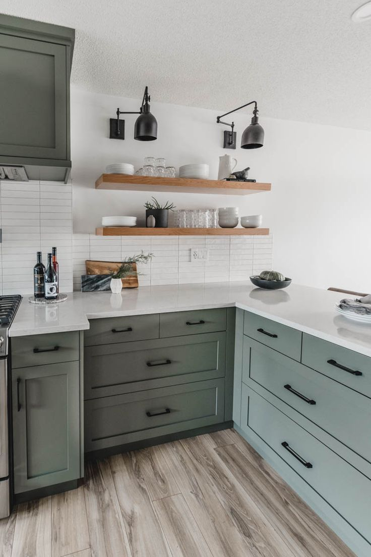 Light wood open shelving in a painted cabinet kitchen green ...