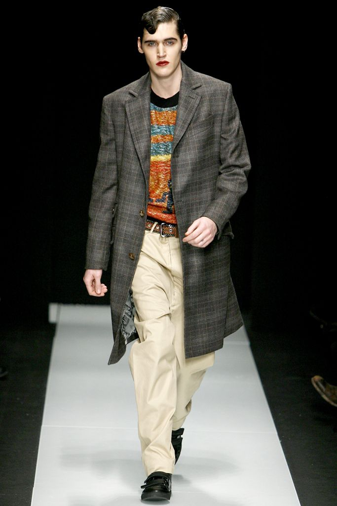 The knee-length jacket is just one indicator that this jacket was inspired by the Zoot Suit. We can also make the assumption that this was inspired by the 1930s-1940s Zoot suit because of the baggy pants. The suit, however, was usually worn with a button up, instead of a sweater, like the one depicted here. 2/28/15