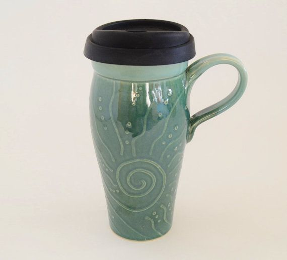 9325acd3674 Stoneware travel mug with silicone lid for keeping beverages hot and spill  proof. This stoneware