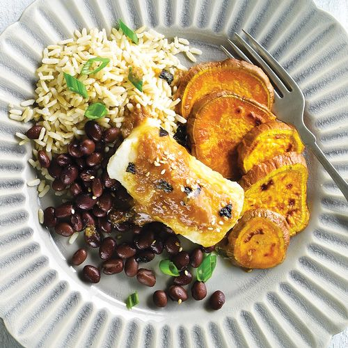 Sweet Miso Cod with Yams, Rice & Beans: Miso-brushed cod is served over brown rice, beans and easy roasted yams for a complete meal.