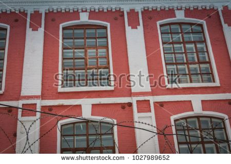 Vintage style windows of an old factory close up.