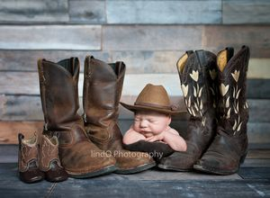 newborn photography. western. cowboy baby with cowboy hat and mom & dad's cowboy boots (his too)
