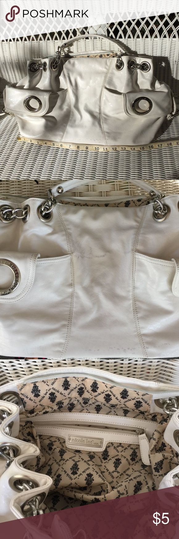 Fashion bag. Big fashion bag to carry everything. Even a laptop 17 inches will fit fine. Bag has a flaw as seen in 2 nd picture ( has a gray sort of marking on it) this is reason priced so low. However flaw is only on one side of bag. Inside is excellent condition. Nicole Lee Bags Satchels