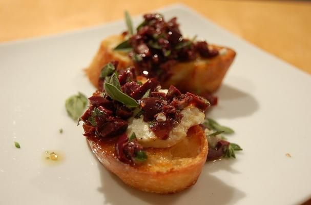 olive, walnut, currant and goat cheese crostini