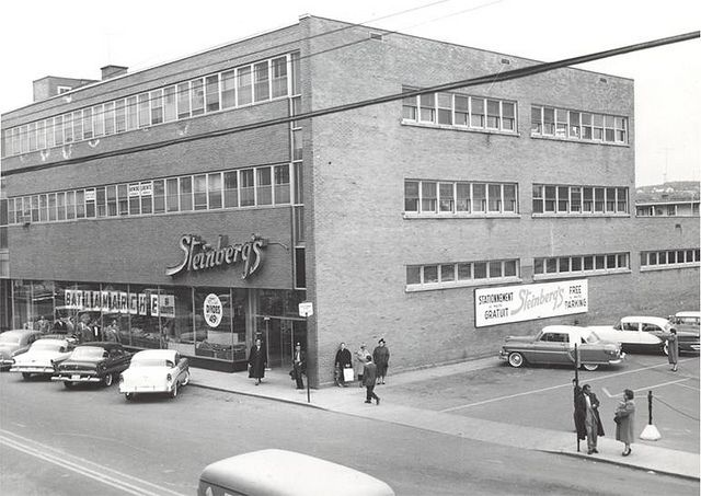 Steinberg's in Chicoutimi (Saguenay). Opened in 1951, closed in 1985 and had a couple of independent market franchises before its space being gutted and turned into office spaces. These days, we can see the labelscar on the storefront brick...
