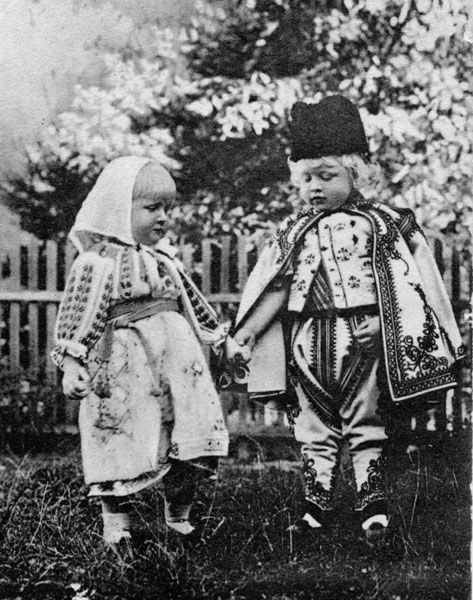 Prince Carol (later King Carol II of Romania) with sister Elisabeth (later queen of the Hellenes) , both in traditional romanian costume. Mids 1890s