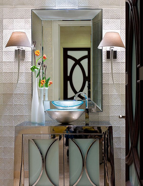 1. Painting and walls have geometric shapes 2. Symmetry with the lighting  3. Glass sink and mirror