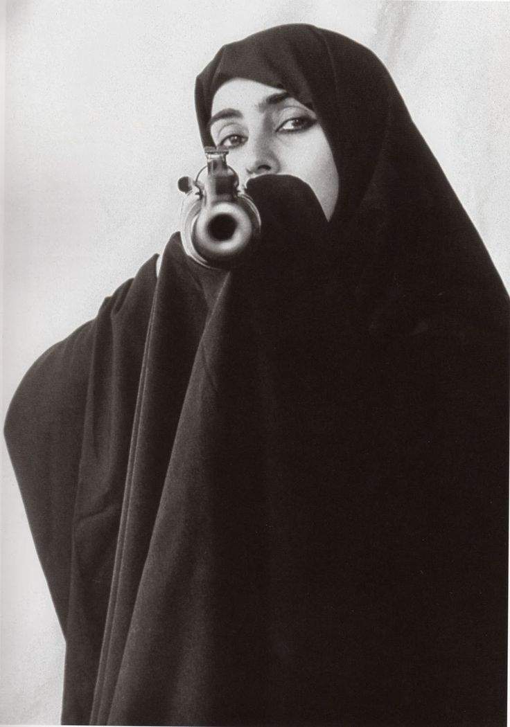Photography by Shirin Neshat part of Women of Allah Series
