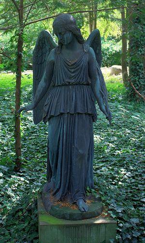 Angel-A darkened statue of an angel found at Vestre Kirkegård. HDR composite of 3 pictures, +/- 1,5 EV.