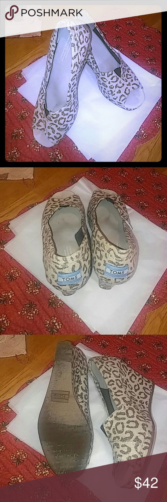 "TOM'S wedge open toe shoes EUC 6.5 wide width Gorgeous animal print wedge shoes natural with brown. Excellent condition and although high they are comfortable to wear because of the 2 3/4"" wedge.  6.5 wide width. Toms Shoes Wedges"