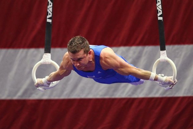 Jonathan Horton competes on the still rings during the 2012 Visa Championships finals, the qualifying meet for the USA Gymnastics Olympic Trials.  Horton won the event title.