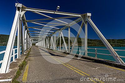 Metallic bridge over the artificial lake of Kastraki, in the region of Etoloakarnania, in Greece.