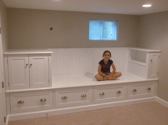 What an awesome idea in a little room! Built-in bench that features five drawers and plenty of storage space in the cabinets above. The bench will be fitted with a custom mattress and can serve as a guest bed. *put some pillows on the top shelf, and you've got a reading nook too! The possibilities are endless!!
