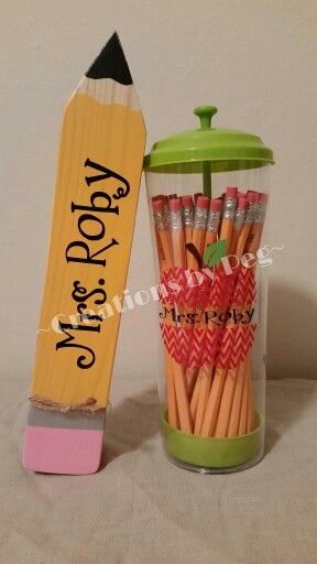 Teacher name plate and pencil dispenser.