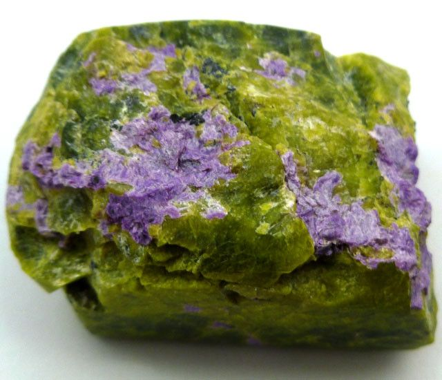 """Atlantisite (also called Tasmanite) is a relatively new discovery in the gem and mineral world. It is a unique combination of colors and includes the yellow-green matrix that holds a purple and green combination of Stichtite, only occurring in """"Stichtite Hill"""" a small hilltop in Zeehan, Tasmania, where it is mined exclusively."""