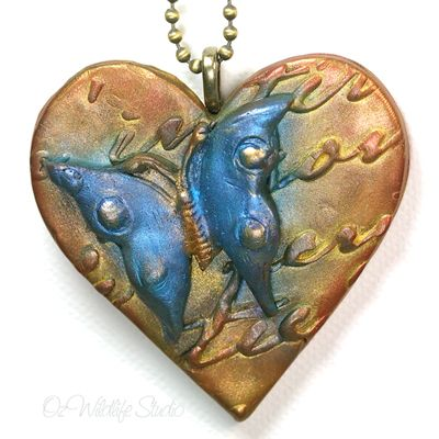 These ornate and decorative butterfly hearts can be made into brooches or necklaces. The butterfly is attached to a heart which contains a relief lace texture and both have been beautified with gorgeous, decadent and lustrous, metallic colours.