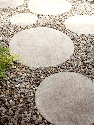 Concrete steppers laid in gravel create a cute pathway that connects the outdoor room to the back of the house. By covering the yard with gravel, the homeowner has very little yard maintenance to deal with, giving him more time to enjoy the fruits of his labor.