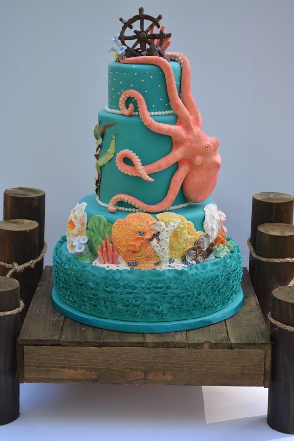 Made for the 2014 Washington State Cake Show. The corals are made from fondant and gum paste. Most were hand molded but I did use silicone molds for some of the bigger ones.  The octopus is RKT and modeling chocolate, all molded by hand.  The awesome pier cake stand was made 2 days before the show by my amazing hubby.