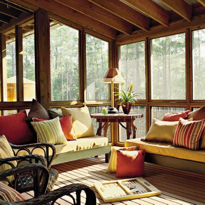 Comfortable lounge seating makes this screened porch a perfect place to relax and take advantage of the summer breeze.