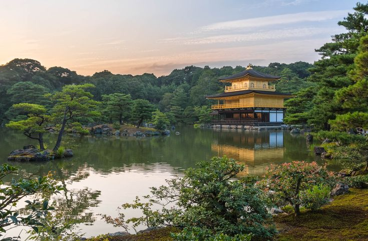 The beautiful Kinkakuji temple in reflected in a pond at sunset. Kyoto, Japan.  This photo is published under Creative Commons Attribution-NonCommercial 3.0 license.