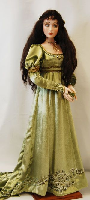 ngelique 2/7 Description: Silk panne velvet gown trimmed with bead embroidery and metallic lace in the style of the late l820's. She has a laced corset and complete underclothes with stockings and leather court slippers. She is 26 inches tall. Painted eyes.