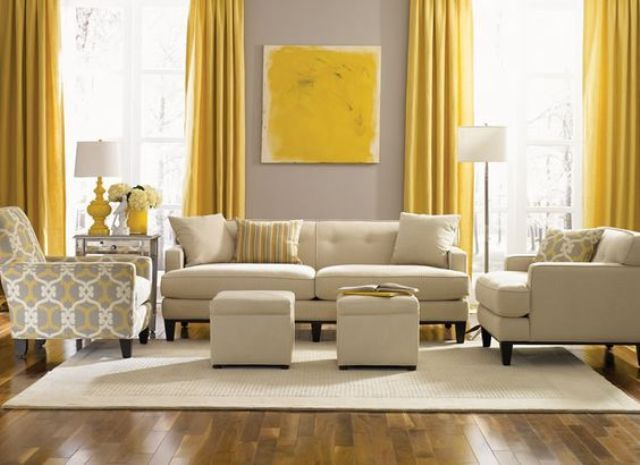 dove grey wall contrasts with sunny yellow curtains and an artwork, the  room is infused