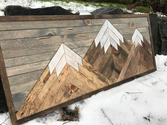 This mountain range wood patterned wall art is made with pine stained different colors to give it a rustic reclaimed wood look. This is a perfect piece for any outdoors lovers! It has three mountains all stained different shades of browns with white distressed mountain tops and a grey stained sky. It measures 36X14 and it comes with a preinstalled wire for hanging.  **NOTE - This piece is made to order. The picture displayed is the template and will be the same design but may have different…