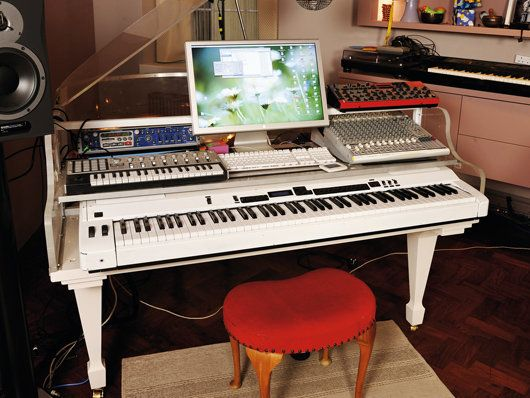 Cool concept, but I think that I would rather have MIDI keyboard on the side, and not in the gutted out body of a mini grand. I think I love acoustic pianos too much to do that to them...